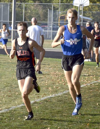 Vincent Mauri, left, of Howland battles Ethan Sparks of Maplewood in the boys race. Mauri finished first.
