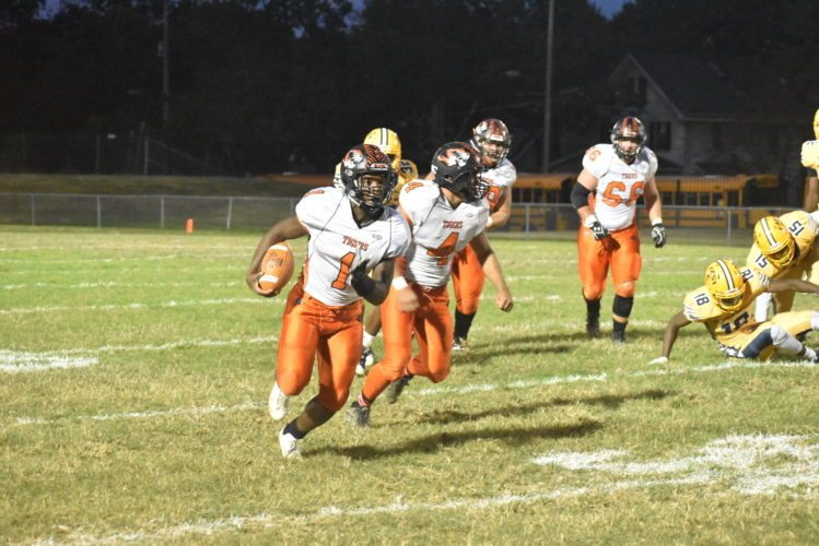 Tribune Chronicle / Marc Weems Howland's Samari Dean (1) runs down field while fellow Tiger Jackson Deemer (4) looks for a block during Howland's 35-12 victory over East.