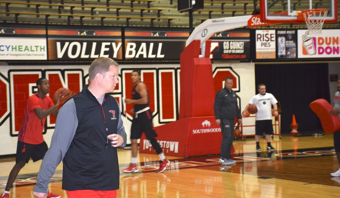 Tribune Chronicle / John Vargo Youngstown State men's basketball coach Jerrod Calhoun watches a recent practice at the Beeghley Center.