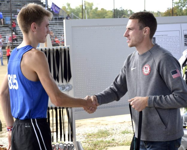 Tribune Chronicle / John Vargo Maplewood's Ethan Sparks, left, is greeted by 2016 800-meter bronze medalist Clayton Murphy on Saturday at The Legends at the Trumbull County Fairgrounds.