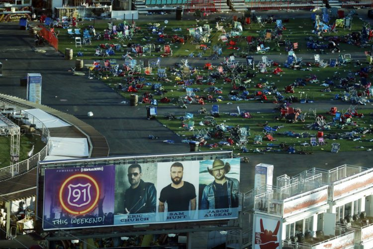 FILE - In this Tuesday, Oct. 3, 2017, file photo, personal belongings and debris litters the Route 91 Harvest festival grounds across the street from the Mandalay Bay resort and casino in Las Vegas. On Sunday, Oct. 1, 2017, gunman Stephen Paddock carried out the deadliest mass shooting in modern U.S. history, leaving Americans try to come to terms with yet another mass murder. (AP Photo/Marcio Jose Sanchez, File)