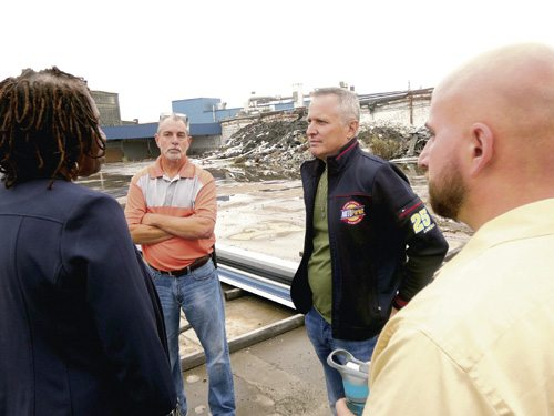 Tribune Chronicle / Raymond L. Smith Christopher Alan, center, explains to council members, from left, Helen Rucker, D-at Large, Mark Forte, D-4th Ward, and Eugene Mach, D-7th Ward, why development of his Auto Parkit manufacturing facility on Dana Street NE is taking longer than expected.