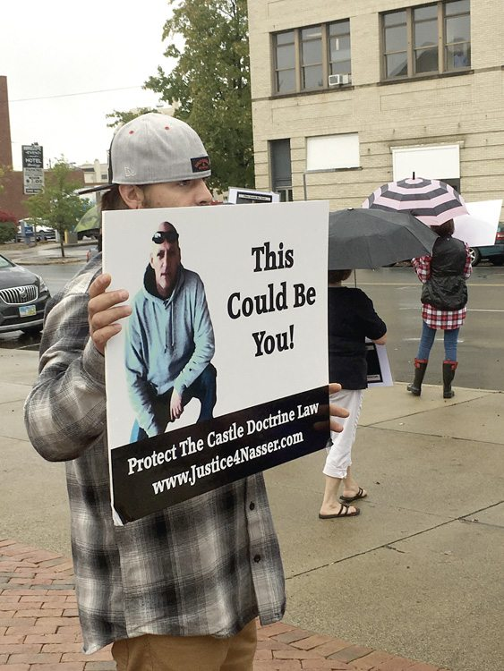 Tribune Chronicle / Renee Fox Brandon Davis of Poland was among about a dozen people protesting outside the Trumbull County Courthouse Wednesday during jury selection in the capital murder trial of Nasser Hamad of Howland. He said as a father, he does not like the way Ohio's self-defense law is written. Hamad's attorneys plan to use a self-defense strategy, according to court filings.