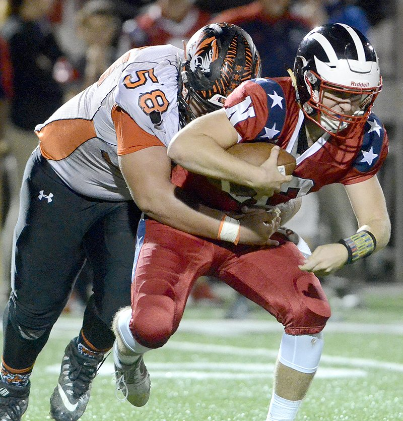 Howland's #58 Jack Lambert sacks Niles' QB #12 Jordan Soda  in the backfield during 2nd Qt. action...by R. Michael Semple