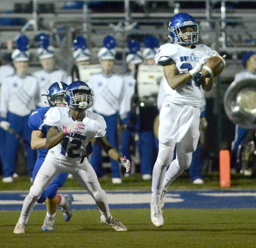 Tribune Chronicle / R. Michael Semple Lakeview's Elijah McMurdy (26) intercepts a pass intended for Poland's Mike Diaz (4) who is covered by Michael Hill (12) of Lakeview Friday night at Poland. Lakeview rallied from a 17-point deficit to beat Poland, 35-30, in the All-American Conference White Tier contest.