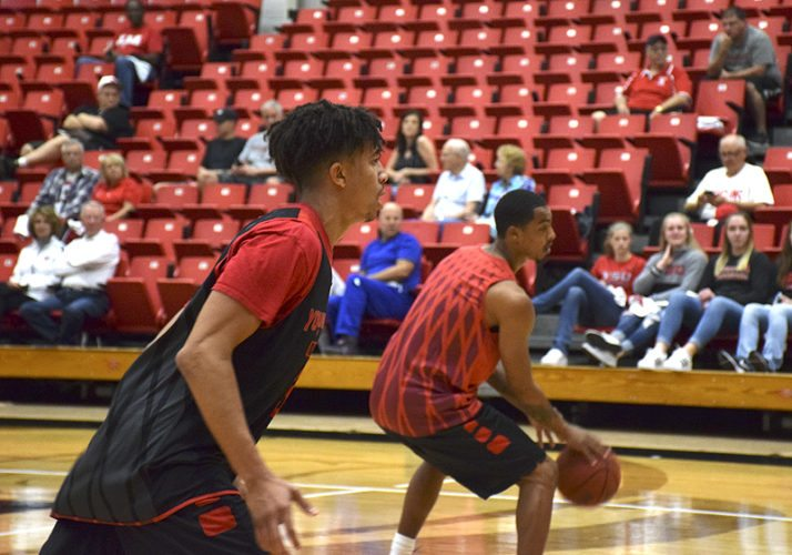 Tribune Chronicle / John Vargo Michael Akuchie, left, and Jaylen Benton of the Youngstown State men's basketball team participate in an open practice Saturday in front of a handful of fans at Beeghly Center.