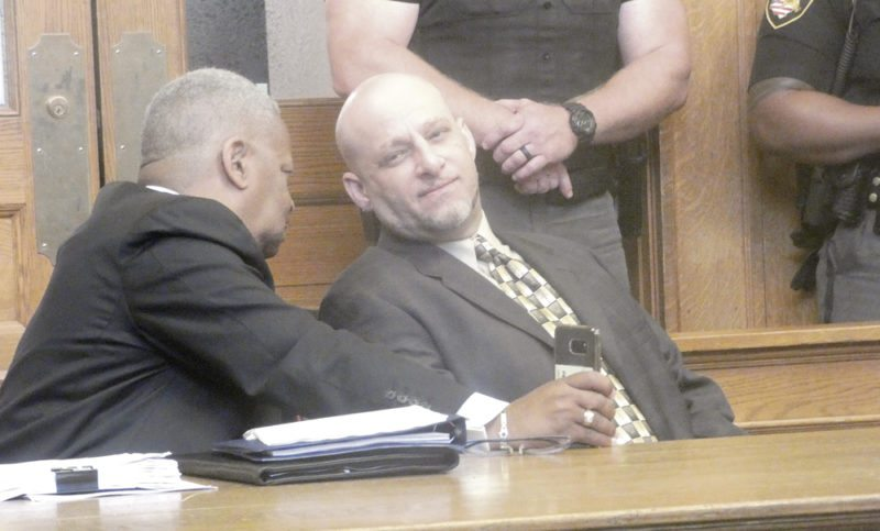 Tribune Chronicle / Guy Vogrin Capital murder defendant Nasser Hamad, right, confers with his attorney, Geoffrey Oglesby, during the first day of jury selection Wednesday. Hamad is facing two counts of aggravated murder with death penalty specifications and six counts of attempted murder for a shooting outside his state Route 46 home in February.