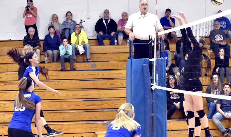 Tribune Chronicle / Marc Weems Maplewood's Maria Danko, far left, hits the ball over the net at Chalker's Caitlyn Stuart, right, defends during Monday's Division IV Lakeview District sectional first-round match. Maplewood's Lori Wakefield, left, and, Kelsey Swogger, center, are also pictured. Maplewood beat Chalker 3-0 to advance.