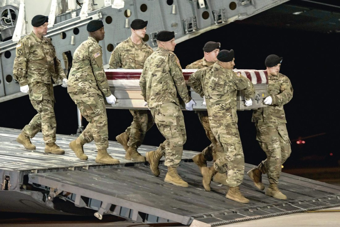 AP / Pfc. Lane Hiser, U.S. Army In this image provided by the U.S. Army, a carry team of soldiers from the 3rd U.S. Infantry Regiment (The Old Guard), carry the transfer case during a casualty return for Staff Sgt. Dustin M. Wright, of Lyons, Ga., at Dover Air Force Base, Del., Oct. 5. U.S. and Niger forces were leaving a meeting with tribal leaders when they were ambushed Oct. 4 and Wright and three other soldiers were killed. There were about a dozen U.S. troops and a company of Niger forces, for a total of about 40 service members, in the joint mission.