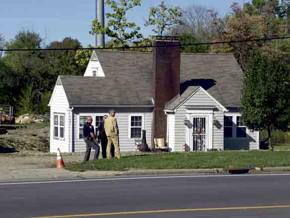 Tribune Chronicle / Jon Wysochanski Law enforcement officers stand guard Friday morning outside the home of Nasser Hamad, who is on trial on capital murder charges in connection to a Feb. 25 shooting that left two people dead and three others injured. The jury visited the location, as well as the impound lot where a van the victims were in is being kept.