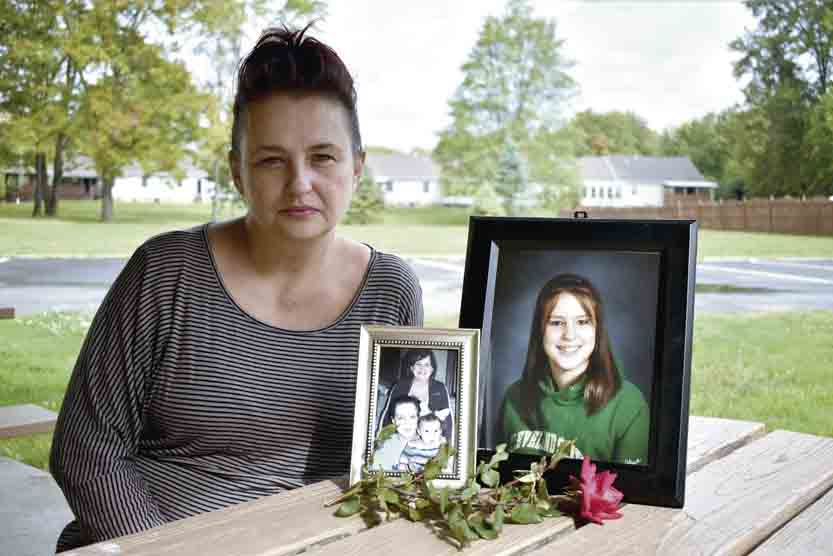Tribune Chronicle / Renee Fox Jennifer Burr said she wants to to see an end to the Riverview Motel on Parkman Road in Warren, where her daughter, Emily R. Burr, in photo at right, died of a suspected drug overdose in August. She was laid to rest during the solar eclipse on Aug. 21. Emily Burr's daughter, now 6, appears in the smaller photograph with Emily in photo at left.