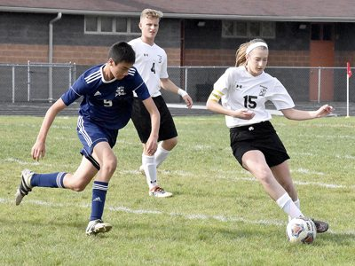 Tribune Chronicle / Marc Weems Ally Ward (15) of Mineral Ridge controls the ball against Kennedy's London Hua Saturday.