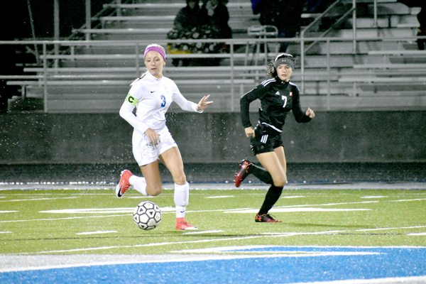 Tribune Chronicle / Marc Weems Lakeview's Reagan Rosenberger, left, dribbles up the field while Cardinal Mooney's Gia Diorio defends during their Division II Austintown district semifinal matchup Monday in Cortland. The Bulldogs won, 3-1.