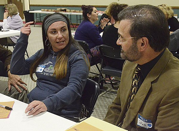 102317...R YOUR VOICE...Warren...10-23-17...Brandi McMurdy of Warren, left, talks addiction issues with Bob Pinti, Deputy Health Commissioner Warren City Health District, during the Your Voice Mahoning Valley meeting held at the Warren YWCA Monday evening...by R. Michael Semple