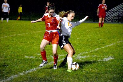 Tribune Chronicle / John Vargo Lordstown's Mya Currence, left, battles Springfield's Kylee Kiser for possession during their Division III district semifinal Monday. Springfield won, 5-1.