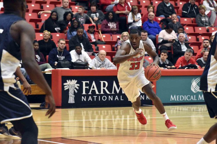 Tribune Chronicle / Marc Weems Youngstown State's Naz Bohannon, center, drove to the lane during Tuesday's game against Thiel in Youngstown. YSU won, 106-74.