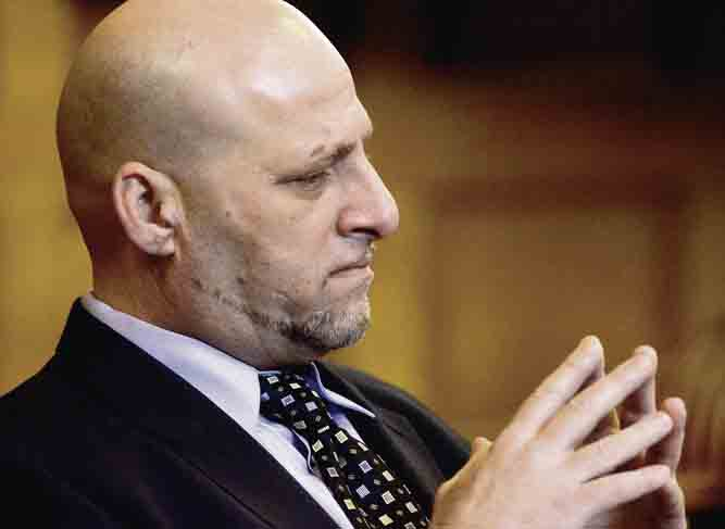 Tribune Chronicle / R. Michael Semple Capital murder defendant Nasser Hamad, 48, listens to testimony Tuesday in the courtroom of Trumbull County Common Pleas Judge Ronald Rice. Police officers, witnesses and survivors of the Feb. 25 shooting outside Hamad's Howland home were among those testifying so far.