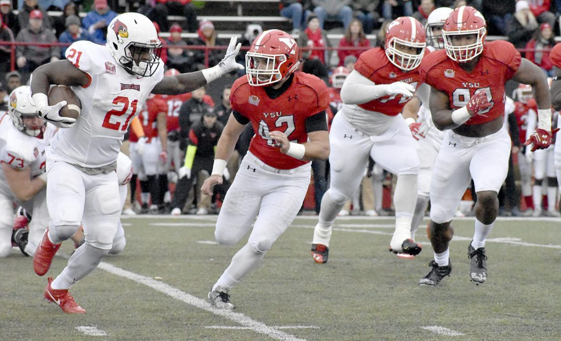 Tribune Chronicle / Marc Weems Youngstown State linebacker Armand Dellovade (42) pursues Illinois State running back Markel Smith Saturday in the Penguins' 35-0 loss.