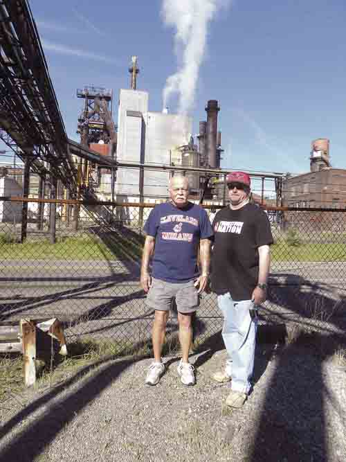 Tribune Chronicle file photo / Virginia Shank Terry Thorpe and his son, Travis Thorpe, in September 2016 catch a final glimpse of the blast furnace at the former RG Steel mill on the southwest side of Warren. Terry Thorpe worked at the plant 43 years as a crane operator.