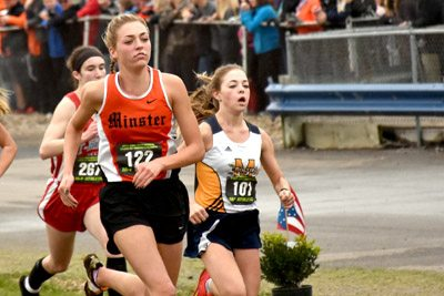 Tribune Chronicle / John Vargo Anna Guerra, right, tries to overtake Minster's Kaitlynn Albers down the stretch in Saturday's Division III girls state cross country race in Hebron. Guerra did overtake Albers, who took ninth. Guerra was eighth.