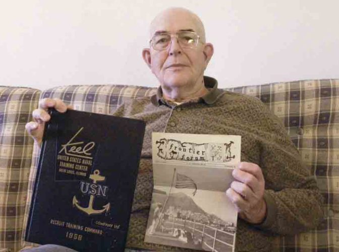 Tribune Chronicle / Jon Wysochanski Melvin Tolley, 78, of Mecca, holds his Navy yearbook and a copy of a publication printed aboard the USS Frontier, on which he served during his time in the Navy.