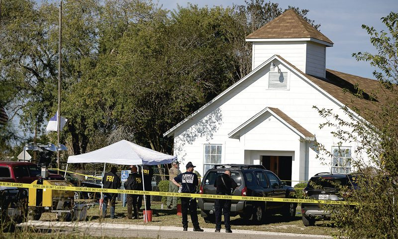 AP / Nick Wagner, Austin American-Statesman Law enforcement officials work at the scene of a fatal shooting at First Baptist Church in Sutherland Springs, Texas, Sunday. A man dressed in black tactical-style gear and armed with an assault rifle killed 26 people in Texas' deadliest mass shooting.