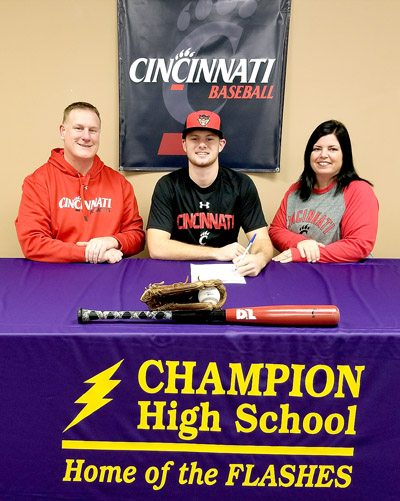 Special to Tribune Chronicle Champion's Drake Batcho, center, poses for a photo with his dad, Joe, left, and mom, Toni, right, Wednesday after signing a National Letter of Intent to play baseball at Cincinnati.