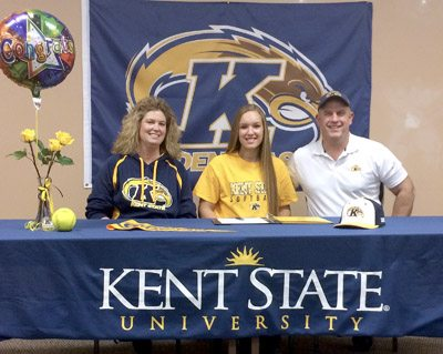 Special to Tribune Chronicle Champion softball player Megan Turner, middle, poses for a photo with her dad, Brian, right, and mom, Christy, left, after signing a National Letter of Intent to play at Kent State.