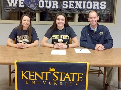 Special to Tribune Chronicle Annie Pavlansky, center, poses for a picture with her father, Tom, right, and mother Kate, left, after signing a National Letter of Intent to play basketball at Kent State University.