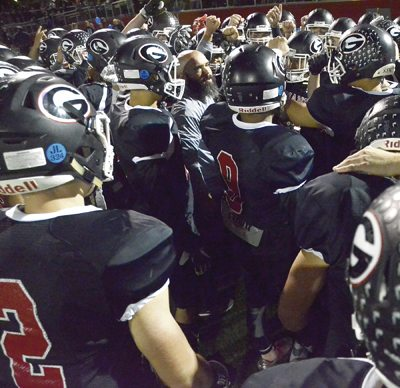 Tribune Chronicle / R. Michael Semple Girard coach Pat Pearson, center, fires up the Indians before a game earlier this season. Girard won its first-round playoff game and now faces second-seeded Perry in a Division IV, Region 13 semifinal at 7:30 p.m. Friday at Twinsburg High School.