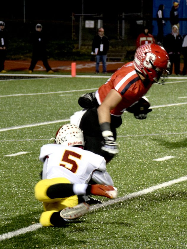 Tribune Chronicle / John Vargo Steubenville's Johnny Agresta is taken down by Cardinal Mooney's Nico Marchionda during Friday's Division IV semfinal at Reilly Stadium in Salem. Steubenville held on for a 19-14 victory.