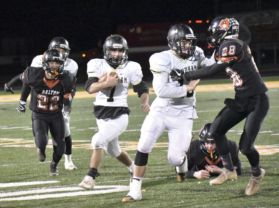 Tribune Chronicle / Marc Weems Phillip Maiorca (1) of Windham runs for yardage behind the blocking of Tyler Collins Friday night against Dalton.