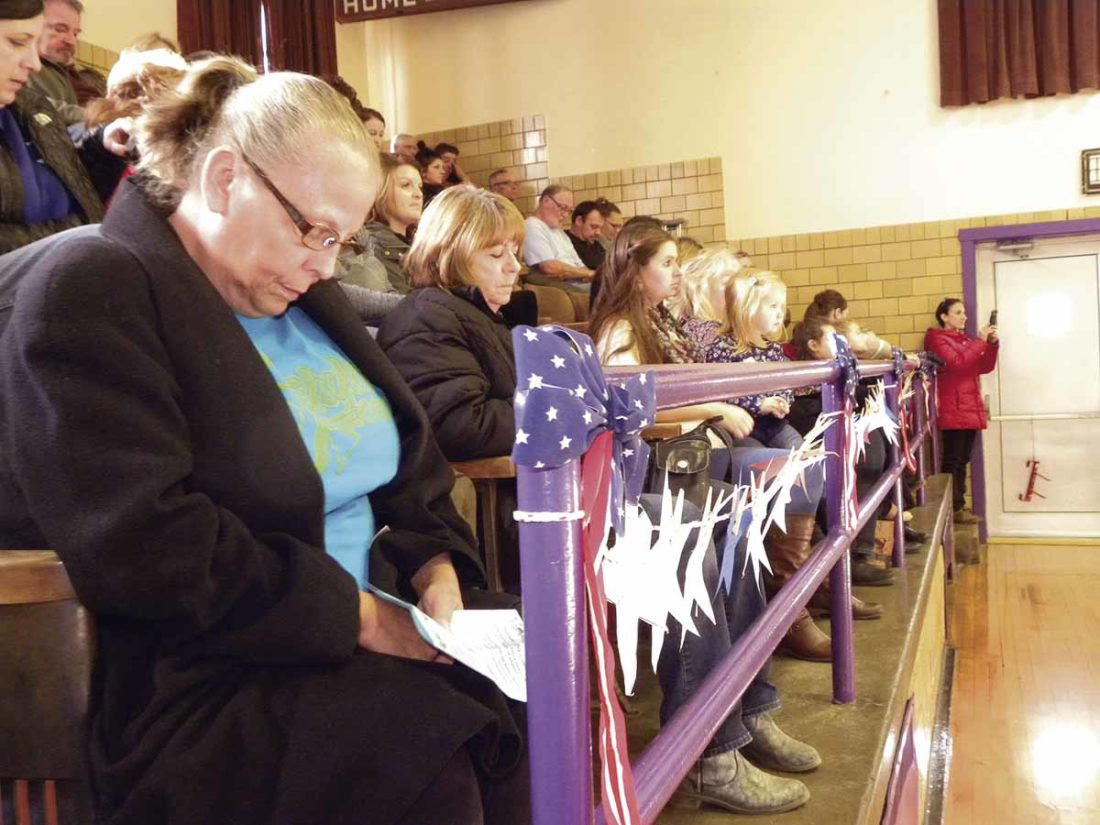 A moment of silence was observed during the ninth annual Veterans Day Community Tribute Friday at Champion Central Elementary School. Several hundred people joined students and staff from Champion schools for the event. Richard Orr of Champion, a U.S. Army veteran, was the honored guest.   Tribune Chronicle / Emily Earnhart