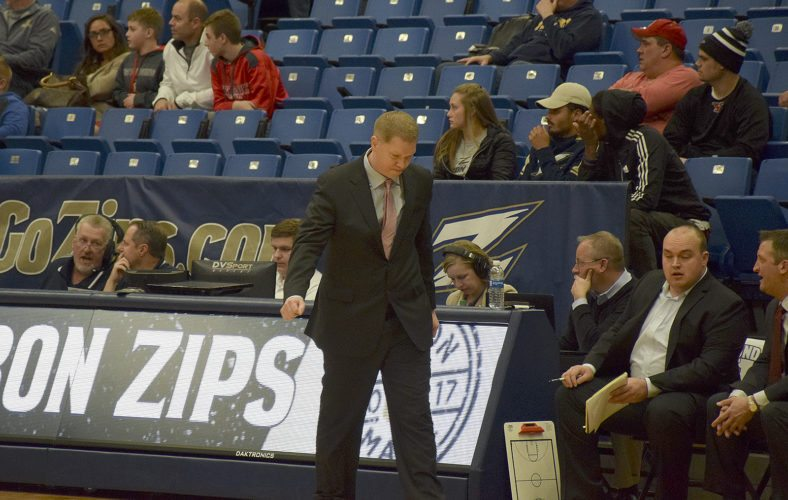 New YSU men's coach Jerrod Calhoun paces the sideline during his debut Saturday night at Akron against Kent State.