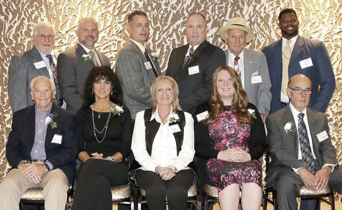 The Trumbull County Sports Hall of Fame held its 15th induction ceremony recently. Those honored in the 2017 class were, front, from left, Bob Sherman, Lisa Naples (accepting for her sister Denise Naples), Lori DiTunno (representing Jody DiTunno), Kelly Barzak, Dave Pappada, (rear from left) Don Szuch, Matt Thiry, Darrin Chapin, Alan C. Wilson, Nick Sabotin (accepting for his brother Lalu Sabotin) and Alfie Burch.
