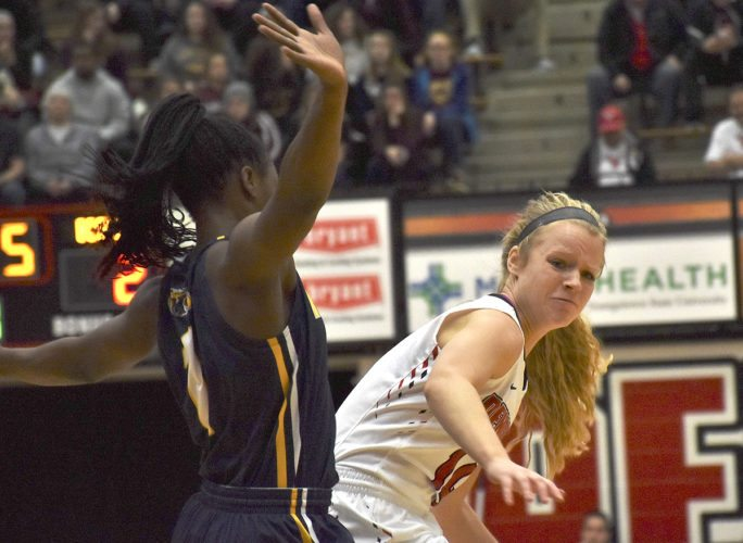 Tribune Chronicle / John Vargo Youngstown State's Melinda Trimmer, right, tries to maneuver against Kent State's Naddiyah Cross Tuesday night at the Beeghly Center in Youngstown.