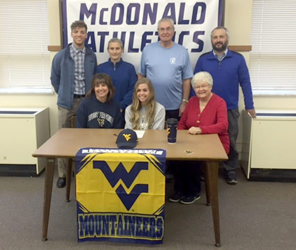Special to Tribune Chronicle McDonald senior Malina Mitchell signed Tuesday to attend and run track and cross country at West Virginia University. Present at the signing were (front, from left) Malina's mother, Nancy Cassidy; Malina; grandmother Rita Creed; (rear, from left) coach Kyle Joynes, coach Mary Domitrovich, grandfather Bill Creed and coach Lou Domitrovich.