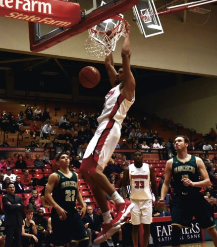 Tribune Chronicle / John Vargo YSU's Devin Haygood goes up for one of many two-handed dunks on the night as the Penguins throttled Franciscan, 134-46, Tuesday night at the Beeghly Center in Youngstown.
