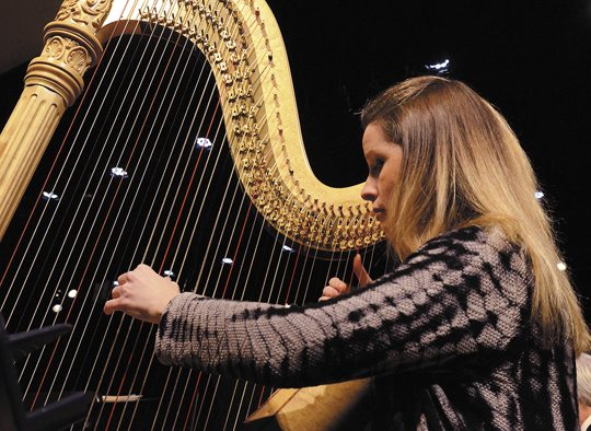 Marissa Knaub Avon plays the harp with the Warren Philharmonic Orchestra at Lakeview High School Friday morning in advance of their Sunday performance at Christ Episcopal Church in Warren.   Tribune Chronicle / R. Michael Semple