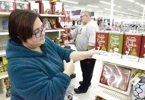 Tribune Chronicle / R. Michael Semple Tracy McBride of Cortland and her husband, Joseph, do some early holiday shopping at Super Kmart in the Eastwood Mall Complex Friday. The National Retail Federation said a recent survey found 22 percent of people planned to start their holiday shopping in October.