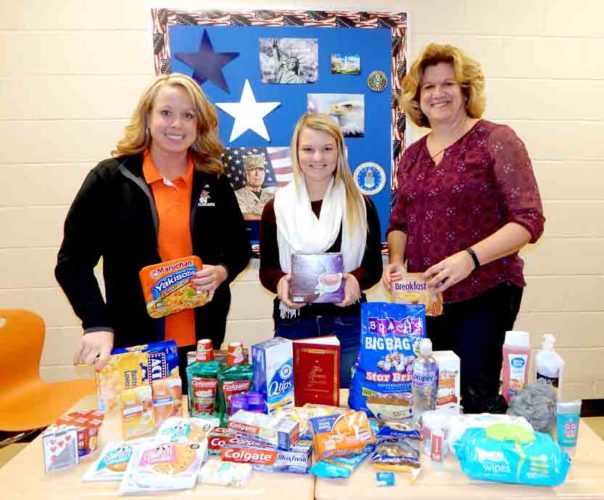 Tribune Chronicle / Bob Coupland Southington students and staff are collecting items through Nov. 28 at the school complex to send to servicepeople overseas in Afghanistan. The goal is to put together 60 care packages for holidays. From left are social studies teacher Jennifer Senkowitz; senior Courtney Warnick, whose brother, Chris is stationed in Bagram, Afghanistan; and business / technology teacher Renee Karr.