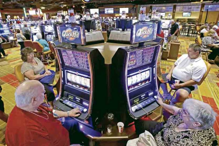 AP Casino patrons play slot machines at the Lady Luck Casino Nemacolin, south of Pittsburgh, in this Associated Press file photo. A decline in gambling at Ohio's four major casinos is causing a loss of revenue shared with Ohio's 88 counties. A new law that will expand gambling in Pennsylvania also could further adversely impact Ohio's gaming revenue.