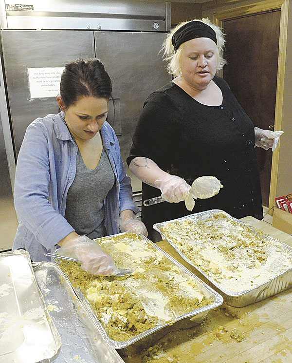112017...R WFM 3...Warren...11-20-17...Volunteer Kristina McKinley, left, from Hannah's House in Vienna, and Hannah's House Director Kim Moore prepare stuffing for the Warren Family Mission annual Thanksgiving dinner this Wednesday...by R. Michael Semple