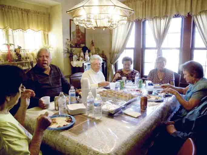 Tribune Chronicle / Emily Earnhart Family brought together following Hurricane Maria in Puerto Rico share a Thanksgiving meal Thursday at the Velazquez residence in Youngstown. The meal begins the Puerto Rican traditional holiday season, which extends into mid-January.