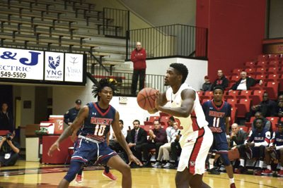 Tribune Chronicle / John Vargo Robert Morris' Koby Thomas, left, guards Youngstown State's Garrett Covington during Wednesday's game in Youngstown. Robert Morris won, 81-74.  Tribune Chronicle / John Vargo YSU's Braun Hartfield, right, tries to make a move on Robert Morris's Dachon Burke during Wednesday's game in Youngstown.