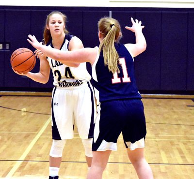 Tribune Chronicle / Marc Weems Brookfield's Bailey Drapola, left, looks to pass against Niles' Emma Delinger during their game Wednesday in Brookfield.