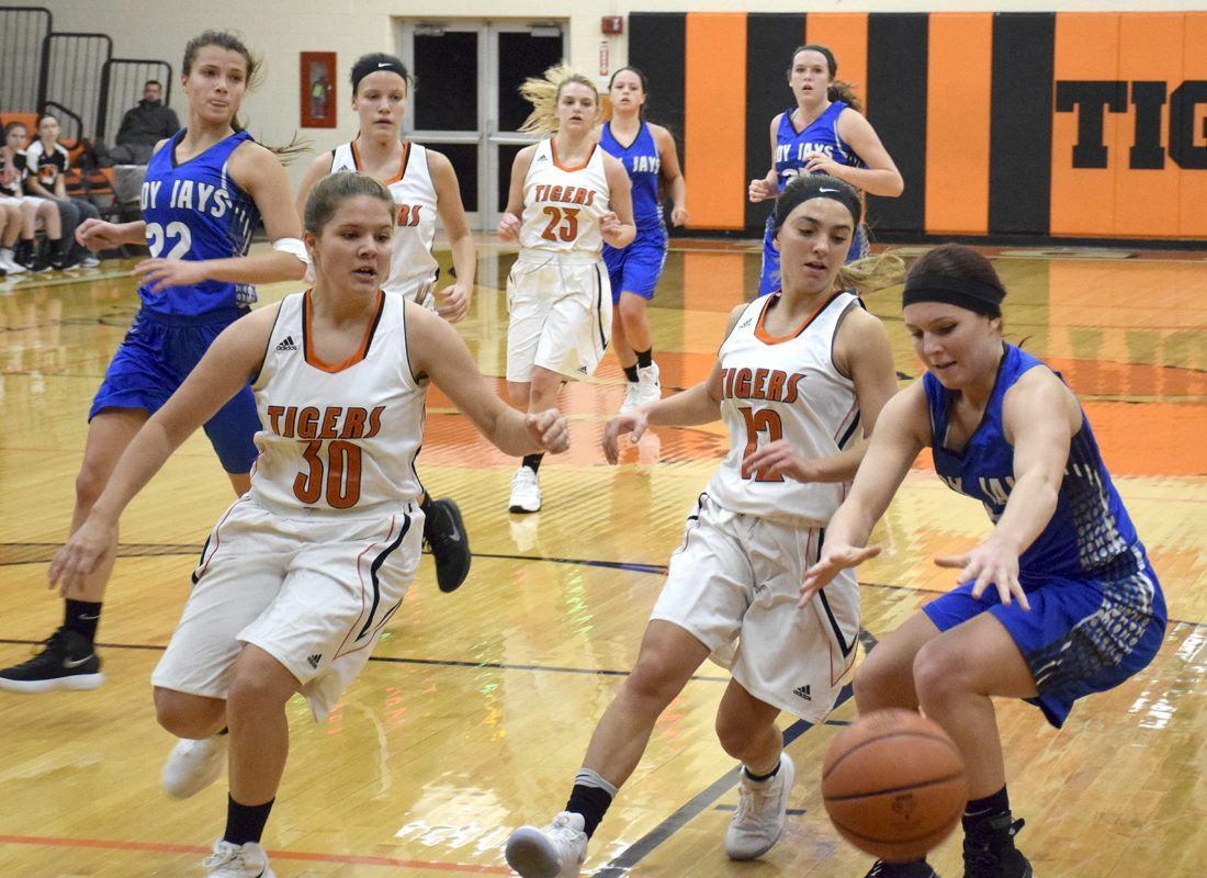 Tribune Chronicle / John Vargo Springfield's Mattisyn Gebhardt, left, and Haley LaMorticella, center, provide pressure as Jackson-Milton's Haley Lengyel loses possession during the second half of Monday's game in New Middletown.