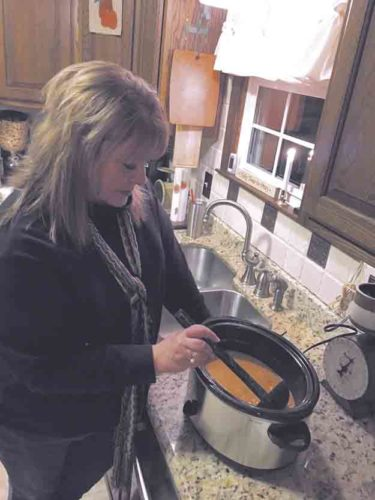 Tribune Chronicle photos / Michelle Jones Rebecca Brothers of Niles stirs Chicken Fajita Soup in the slow cooker just before serving.