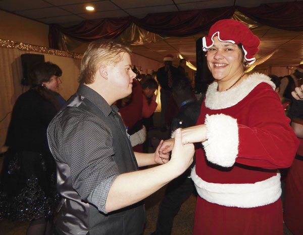 Tyler Meinke, 18, of Cortland dances with Mrs. Claus (Toni Tricoli) at the Winterfest Dance held Wednesday.