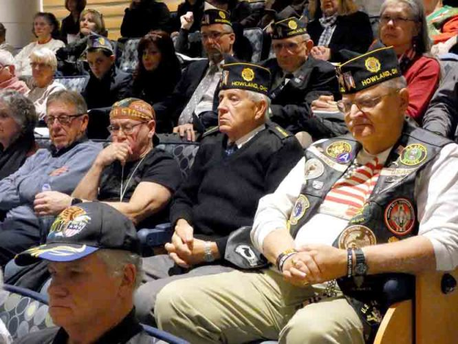 Tribune Chronicle / Raymond L. Smith  Military veterans listened intently Thursday evening during a Pearl Harbor Day event at Kent State University at Trumbull campus, which was co-sponsored by the Tribune Chronicle and the university.